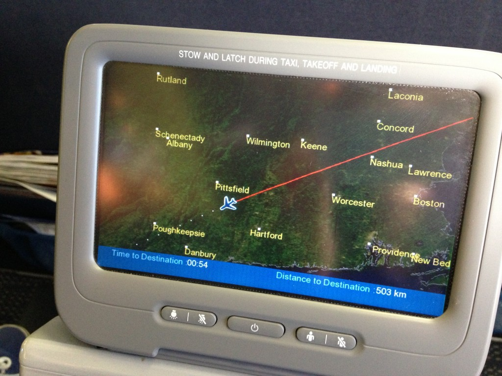 map of flight route on tv screen of airplane