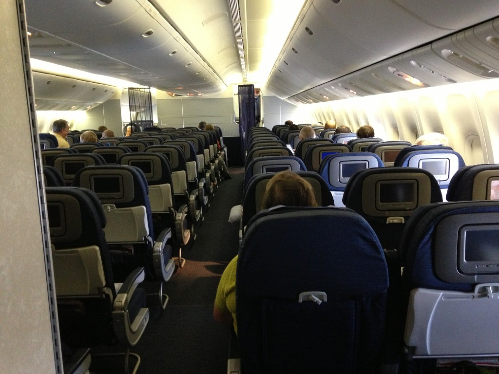 rows of airplane seats from back