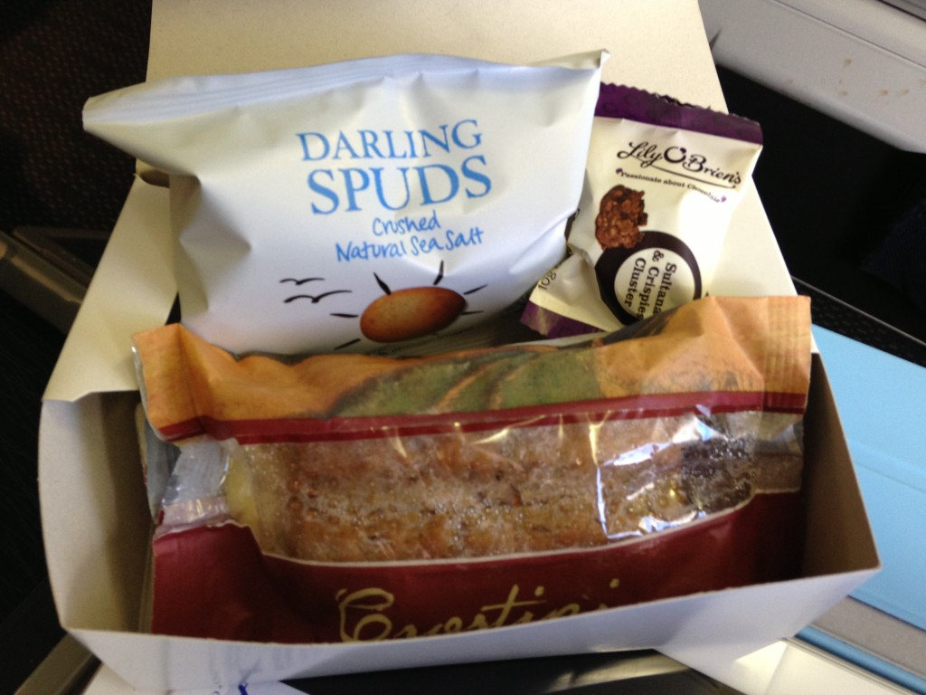 airplane snack box with chips, candy, and sandwich