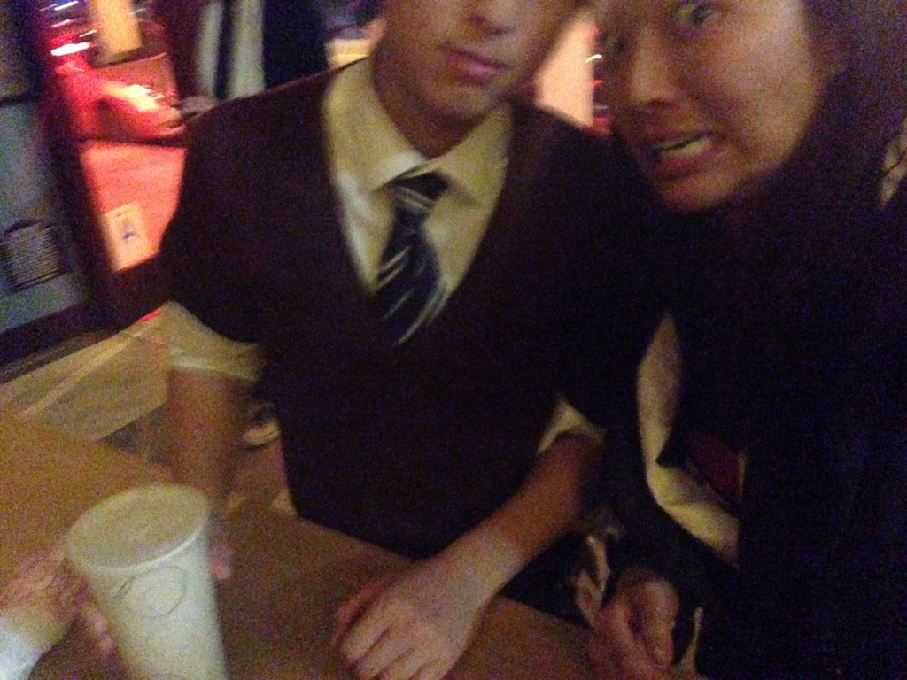 blurry selfie with terrible aim of part of new friend at pizza place