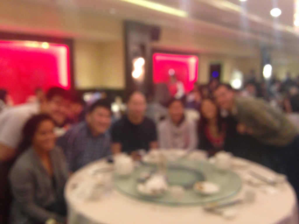 blurry shot of group of friends at dim sum restaurant table