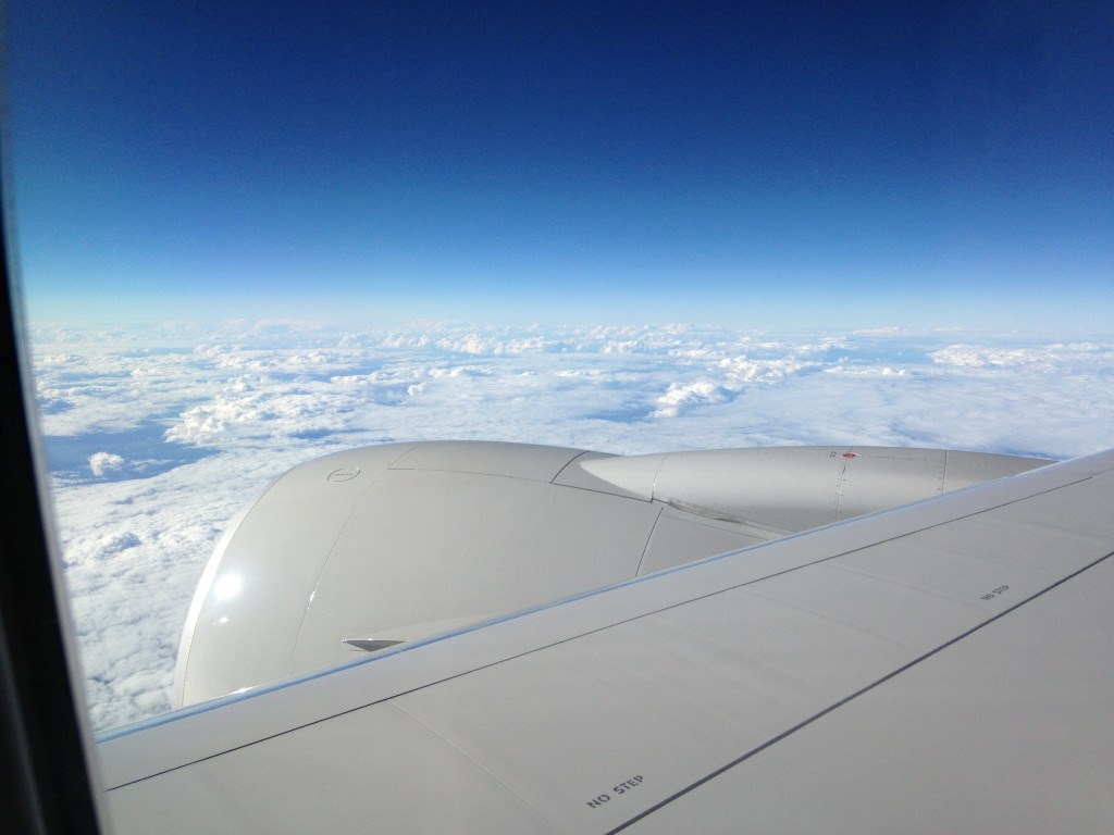 sheet of white clouds viewed over plane wing