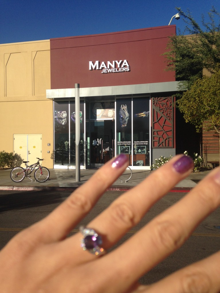 manya jewelers storefront at valencia town center mall with engagement ring made there in foreground