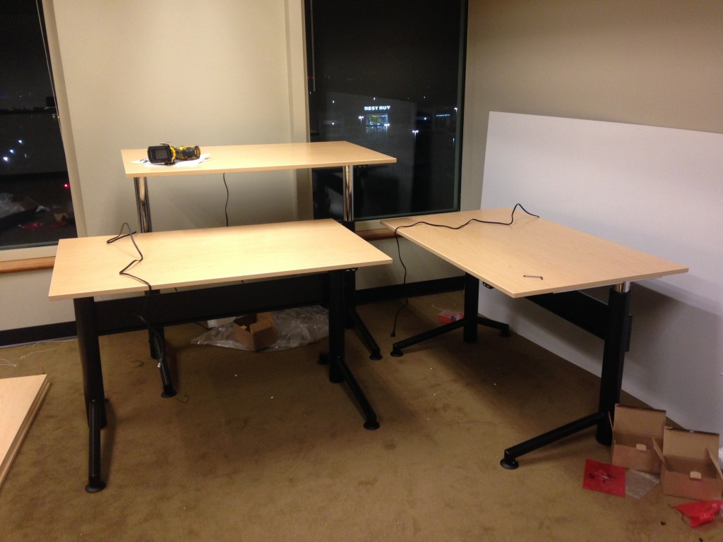 three motorized desks newly built with adjustable heights