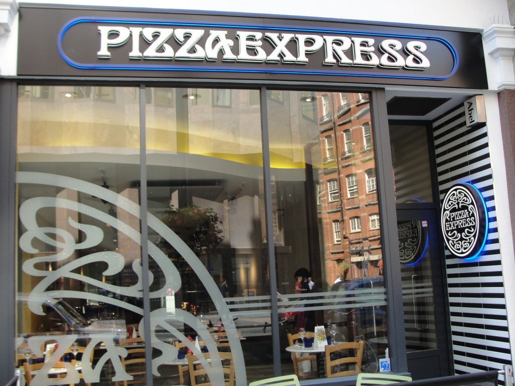 front of pizza express restaurant in london