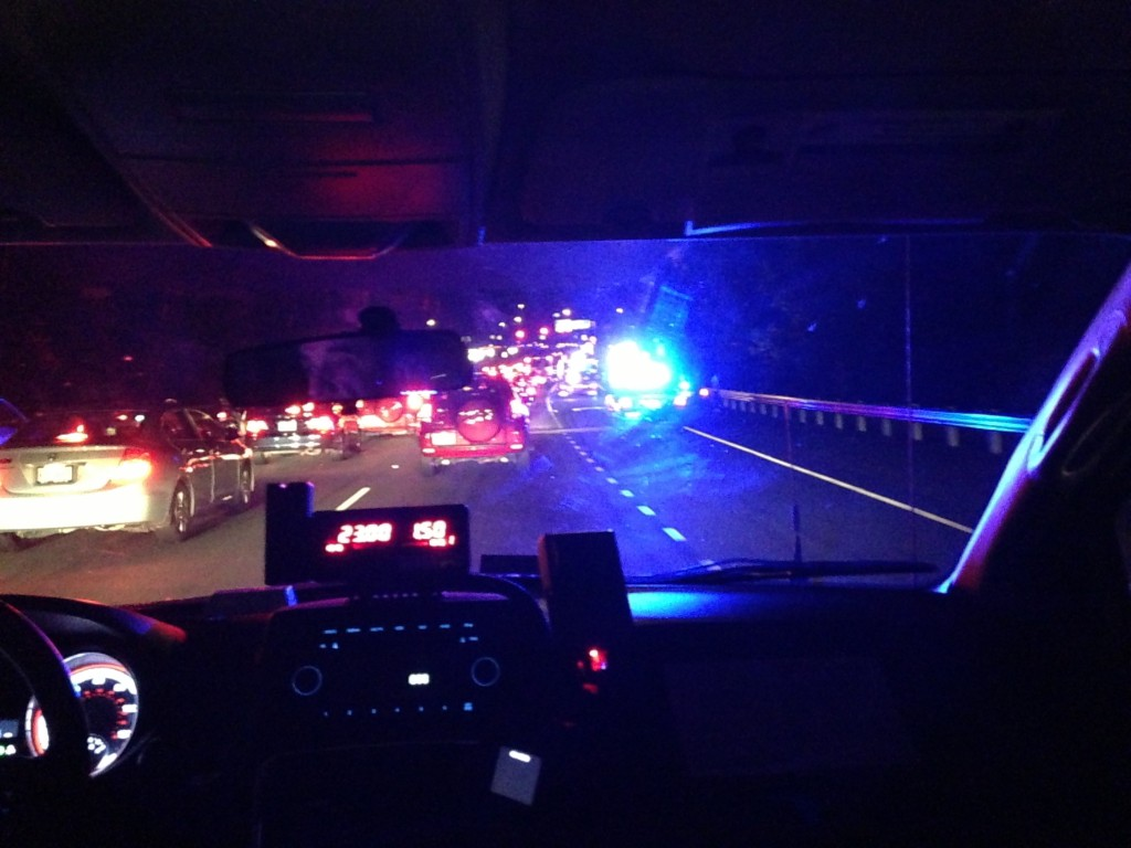 bright blue virginia police lights viewed from back of taxi