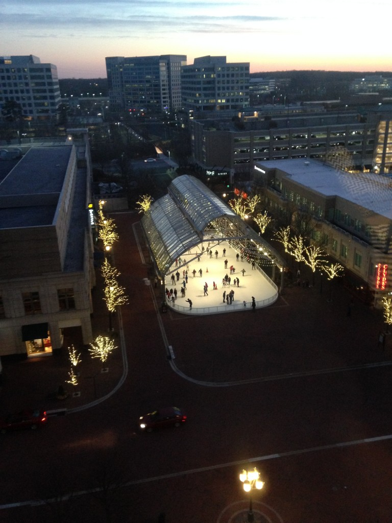 view of reston town center ice rink and sunset in distance from nearby building