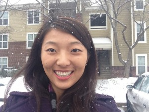 happy girl smiling taking a selfie with snow falling around her
