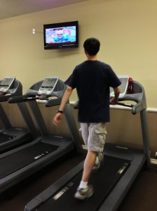 guy walking on treadmill with confident stride