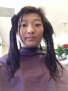 wet hair clipped forward ready to get cut at salon