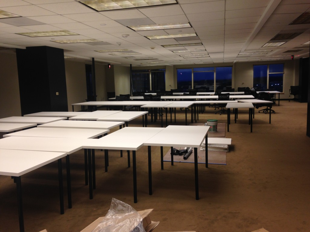 large room with tons of white desks