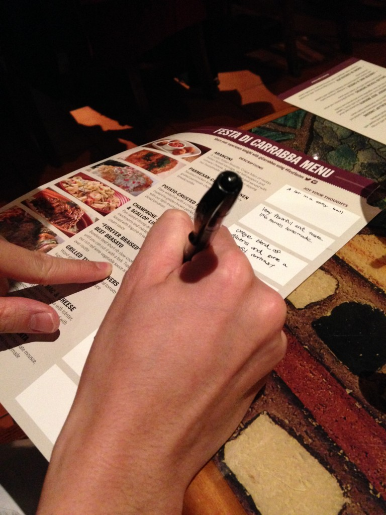 writing down thoughts of samples served at festa di carrabba first tastes event