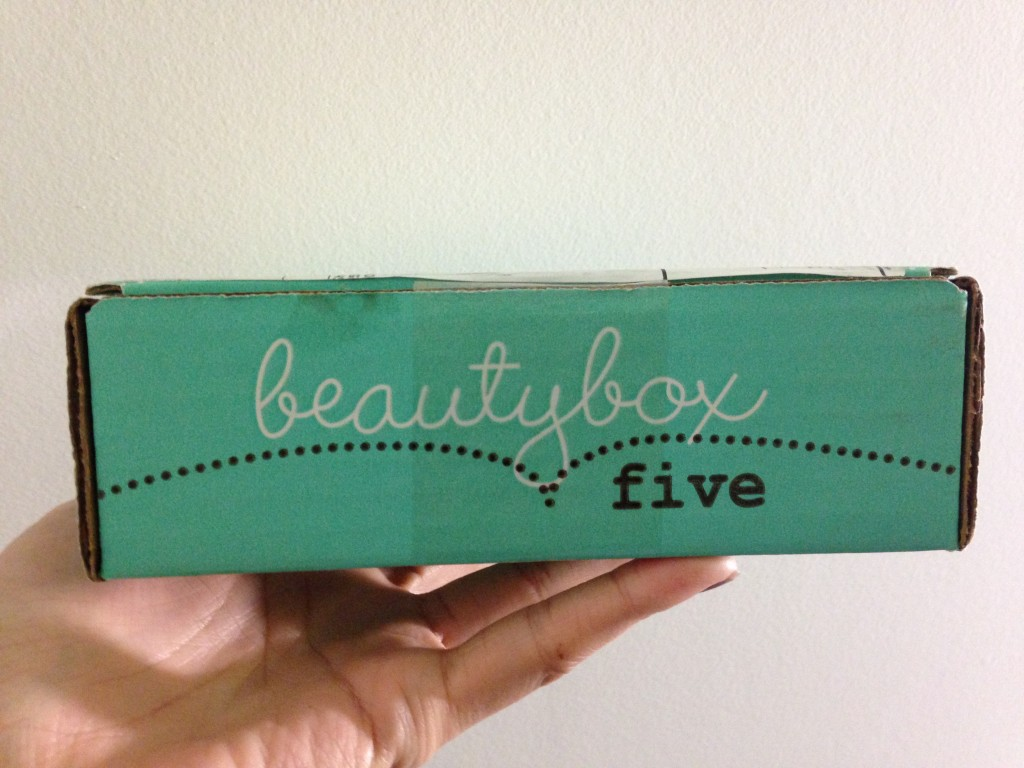 beauty box five held up by hand