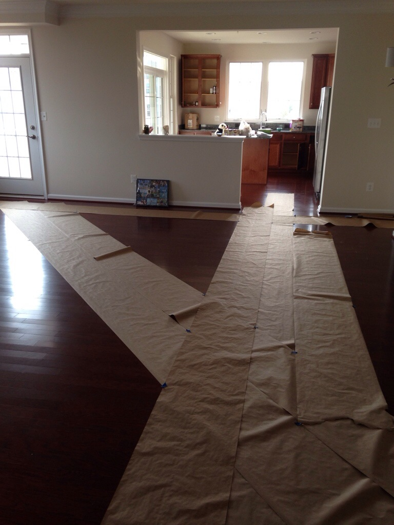 brown paper paths laid down in condo to protect floor from move