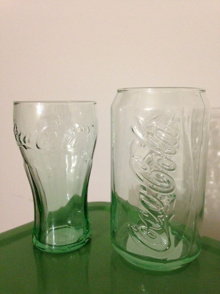 coca-cola glasses with one in shape of soda can