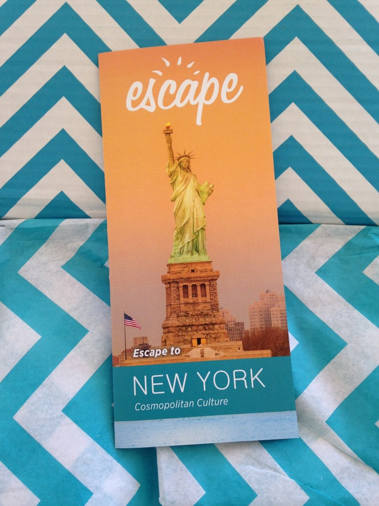 escape monthly february new york box info card against blue and white chevron background