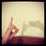 hand casting shadow puppet on wall