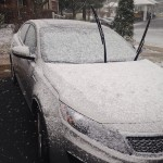 light dusting of snow on car with windshield wipers up