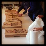board room table filled with pizza boxes for lunch