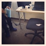 white bb gun pellets scattered across floor and office chair
