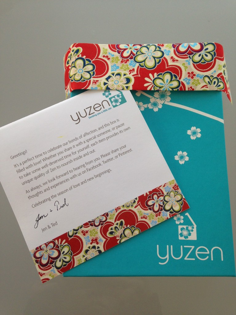 yuzen box with white flowers on aqua background and spring info card