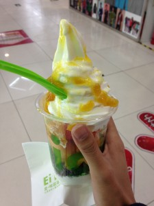 cup of chinese frozen yogurt with fruit toppings