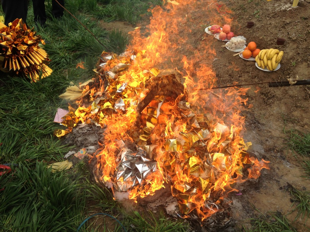 fire burning fierce with new shiny paper money offerings