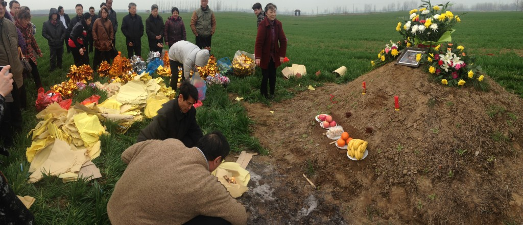 extended family gathering at grave site for memorial