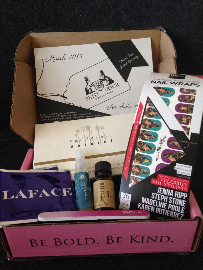 contents of petit vour march 2014 box with laface lotion, lotus wei serum, icon oil, ncla nail wraps and nail file, and california naturel skincare set