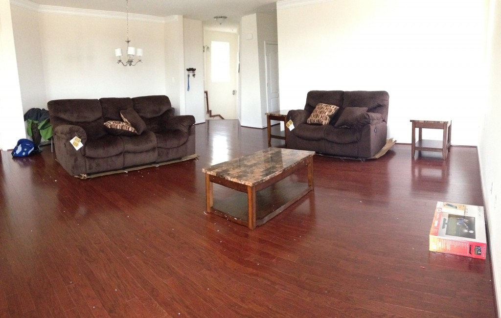 new couch set with two couches, coffee table, two end tables, and pillows