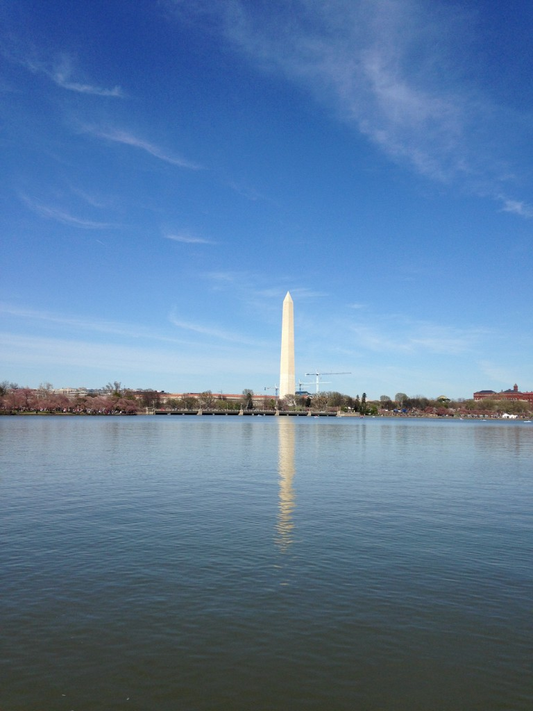 view of washington monument from across tidal basin with reflection in water