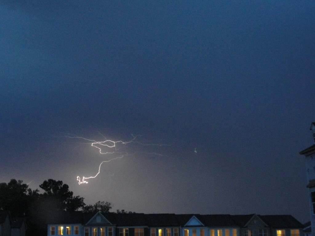 curling lightning bolt in dark sky
