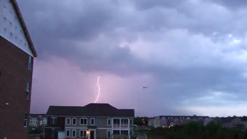 plane flying near lightning bolt