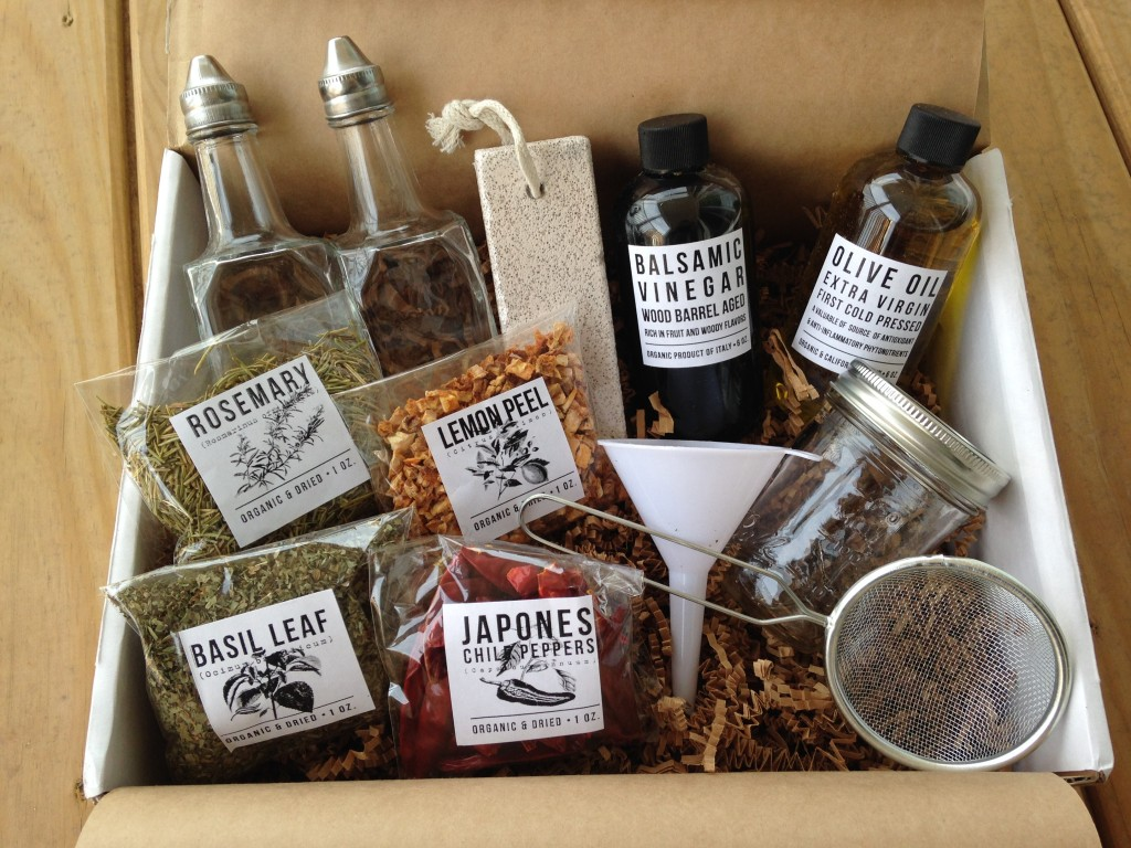 contents of the homegrown collective may 2014 box with olives grapes herbs oh my theme