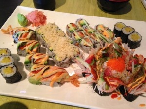 five types of sushi rolls on single platter