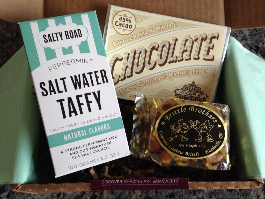 treatsie june 2014 box contents with salty road salt water taffy, olive & sinclair chocolate bar, and brittle brothers cashew brittle