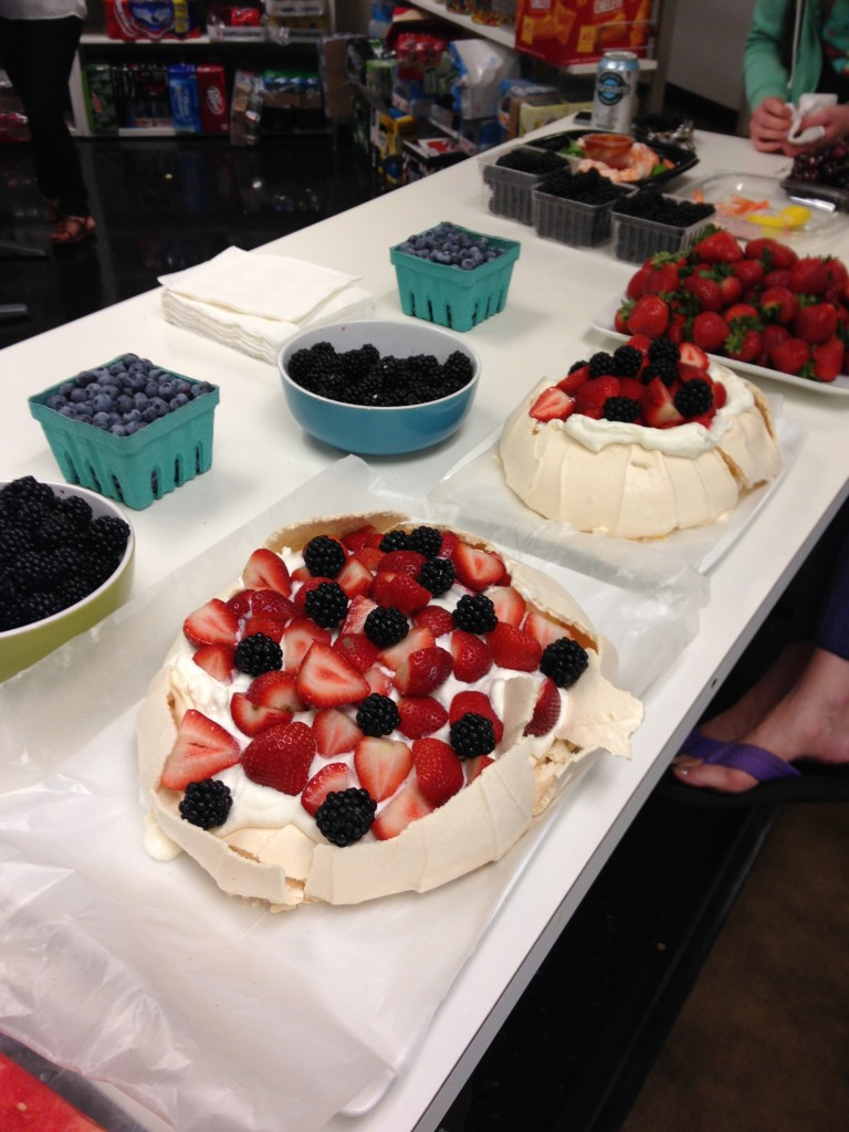australian pavlova desserts, blackberries, blueberries, cherries, and other fruit for office happy hour