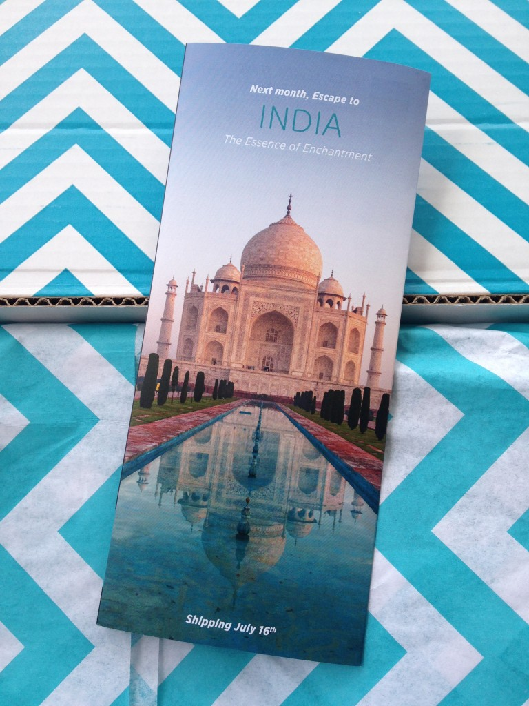 escape monthly june las vegas box info card back with preview of next month's box theme of india