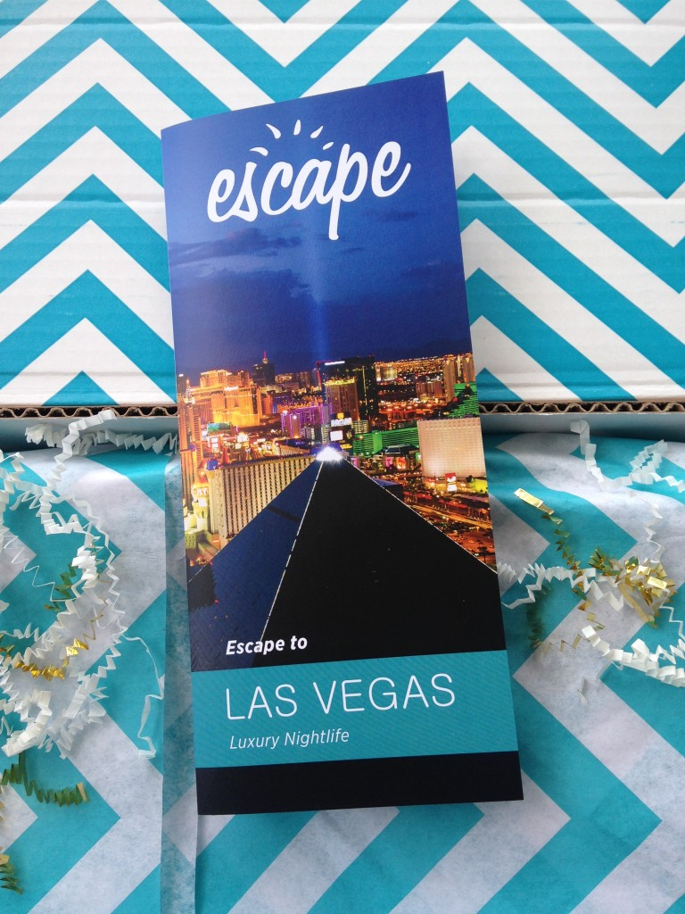 escape monthly june las vegas box info card against blue and white chevron background