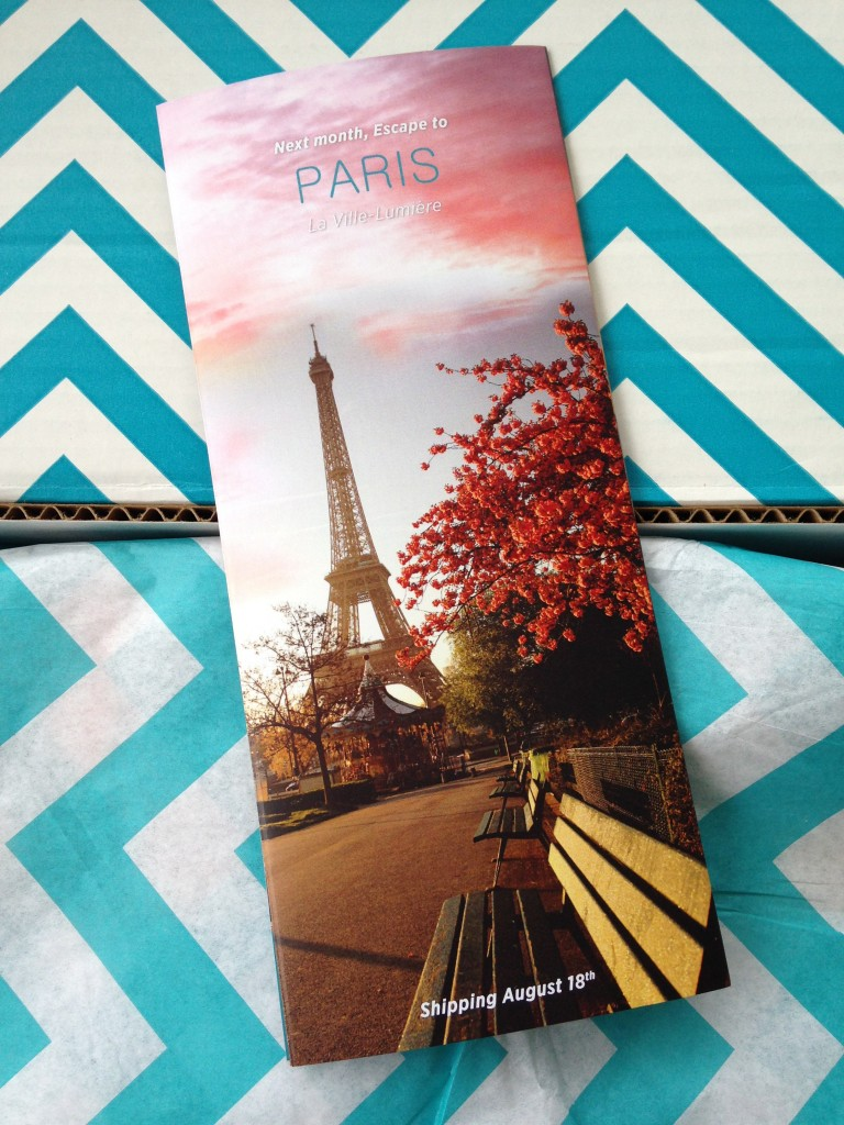 escape monthly july india box info card back with preview of next month's box theme of paris