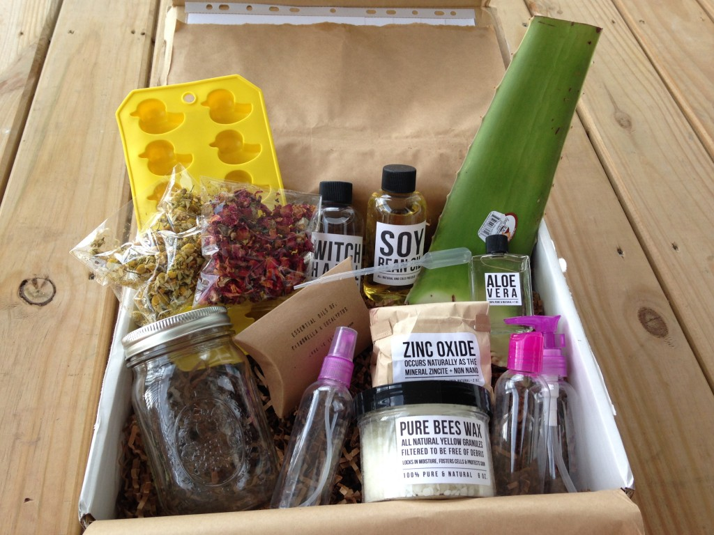 contents of the homegrown collective june 2014 box with summertime & the livin's easy theme