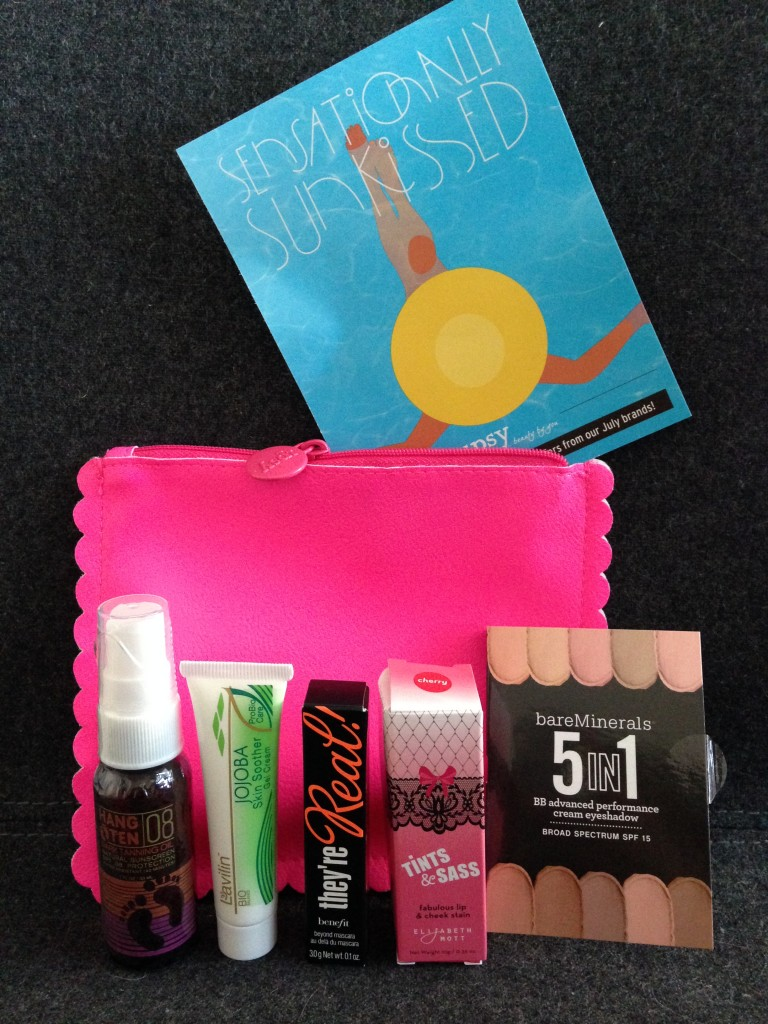 ipsy july 2014 bag items with card including hang ten tanning oil, lavilin jojoba skin soother gel cream, benefit they're real mascara, elizabeth mott tints & sass lip & cheek stain in cherry, and bareminerals 5 in 1 cream eyeshadow in divine wine