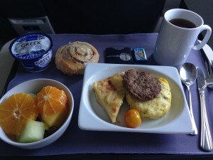 tray of hot breakfast offered in first class of united flights