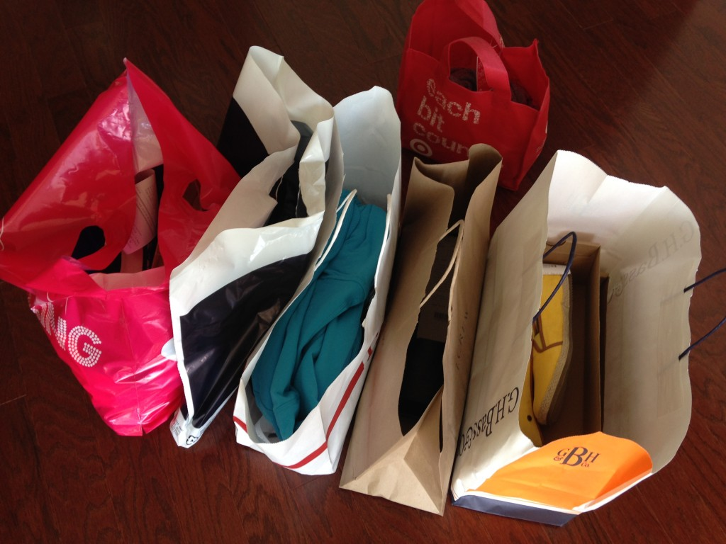 shopping bags lined up after trip to outlet