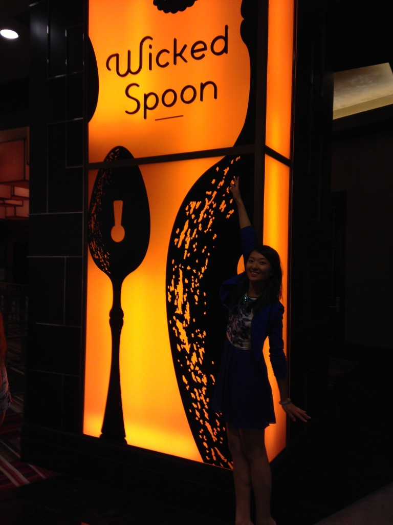 standing by wicked spoon sign