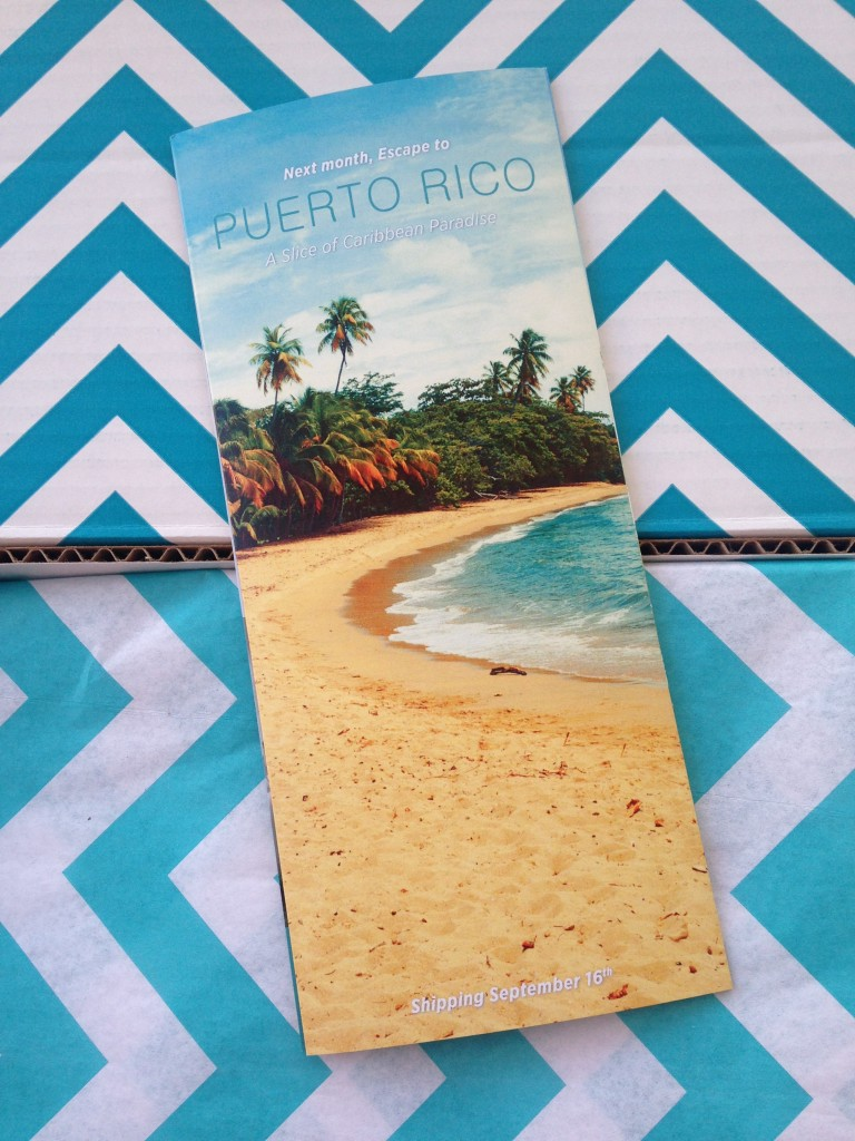 escape monthly august paris box info card back with preview of next month's box theme of puerto rico