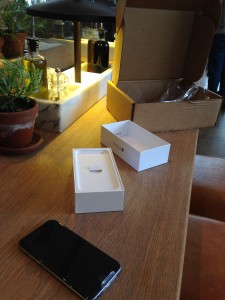 iphone 6 and boxes being opened at vapiano's