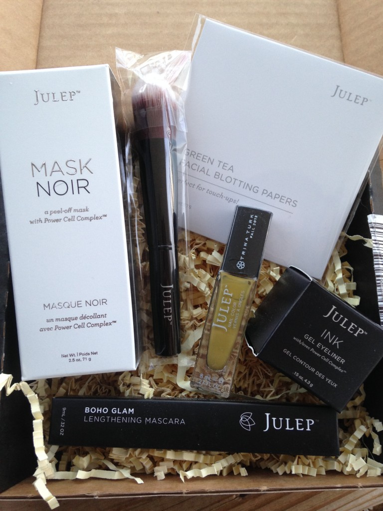 julep jewel heist mystery box contents including mask noir, double duty makeup brush, green tea blotting papers, gel eyeliner, lengthening mascara, and polish in alma