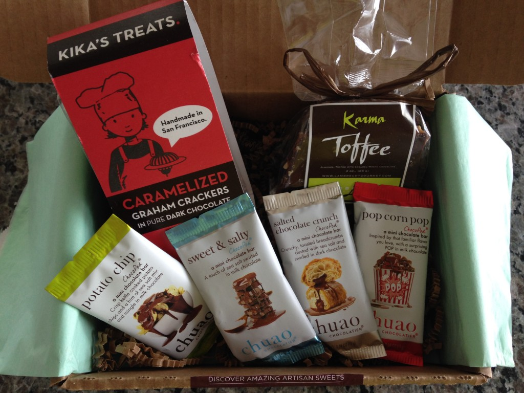treatsie august 2014 box contents with kika's treats caramelized graham crackers in chocolate, lambrecht gourmetkarma toffee, and chuao chocolatier chocopods