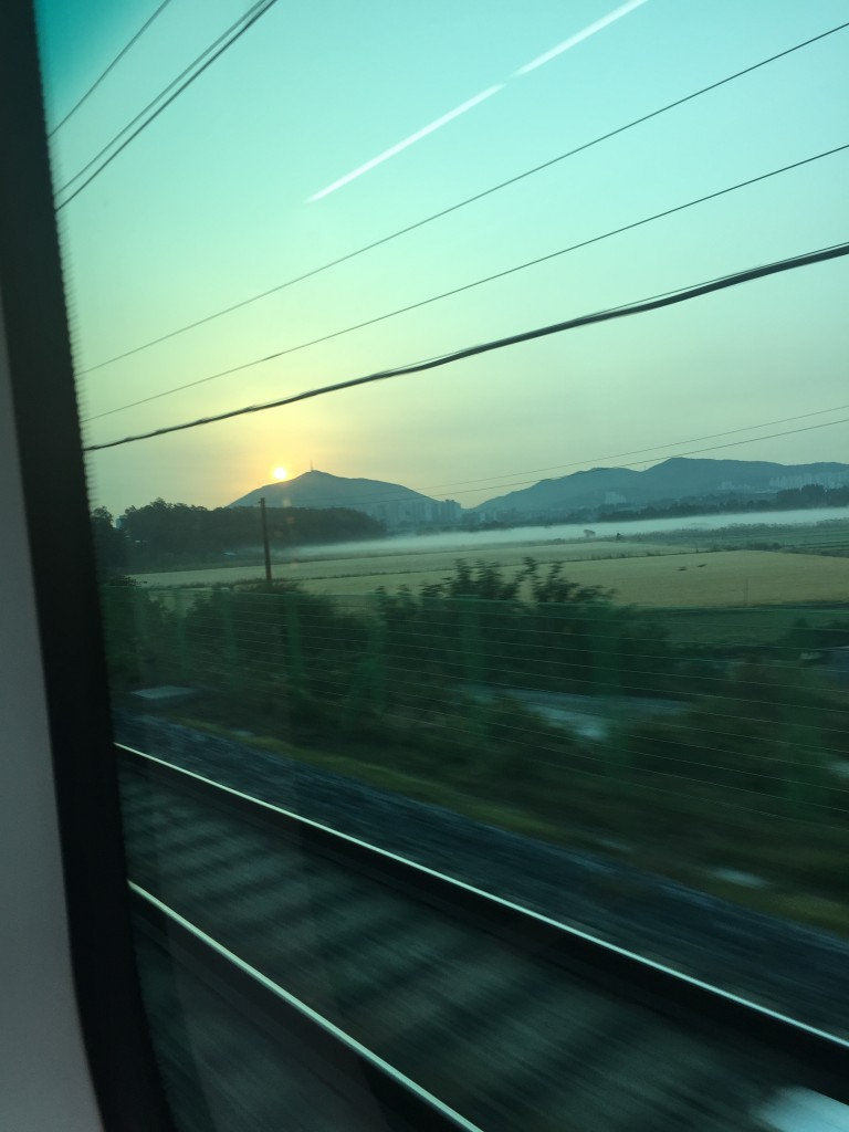 view of sunrise from arex airport express connecting incheon airport to seoul station